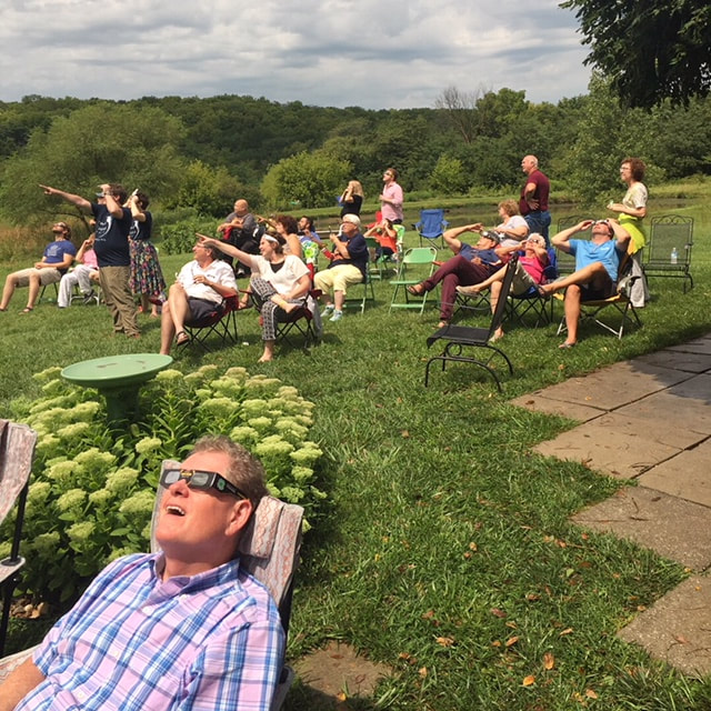 Viewers watching the 2017 eclipse wearing glassed